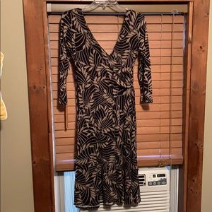 Dress barn tan and black deep v in front/back